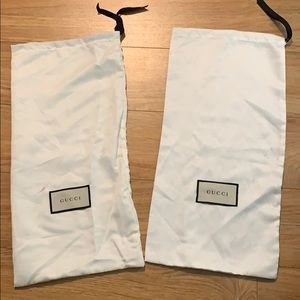 Two Gucci duster bags